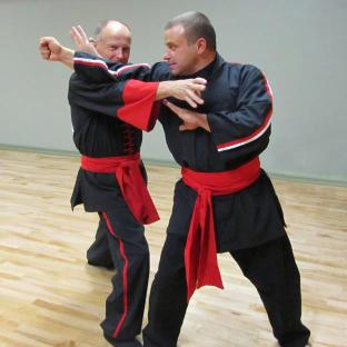 Masters Mike Kazakoff and DJ Swanstrom demonstrating a technique in class